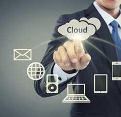 Business man pointing at cloud computing